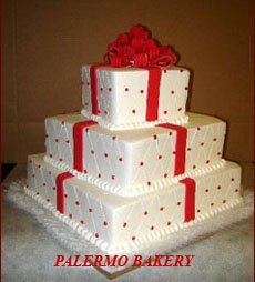 Christmas wedding decoration ideas of a christmas wedding cake made to look like a present