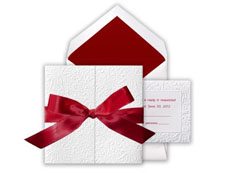 Christmas wedding invitations with red ribbon