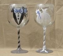 Engraved wedding gifts of glasses for bride an groom