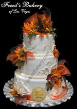 Picture of fall theme wedding cakes with orange and yellow flowers