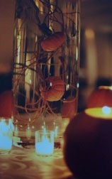 Centerpieces with pumpkins inside