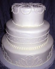White wedding cake with a simple pearlized decoration