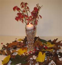 Stunning centerpieces  floating candle with leaves and flowers