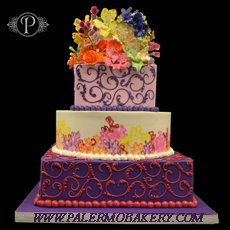 Many colored wedding cake consisting of purple, pink, yellow blue and orange.Unusually colored and designed wedding cakes