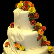Beautiful cake with autumn colored flowers