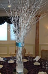 Winter centerpiece of white sticks and snow