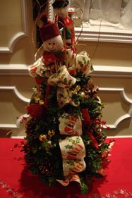 Winter Wedding Reception Centerpieces Decorated with ornaments found at a craft store