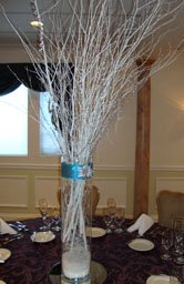 Tall wedding centerpieces of white branches