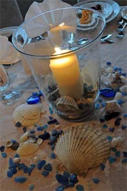 Beach Wedding Idea with candle seashells and blue rocks