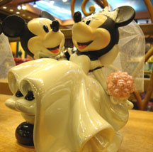 Disney wedding theme cake topper of Mickey holding Minnie