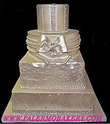 Picture of a white on white pearlized wedding cake.