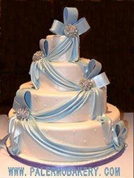 Elegant  wedding cake with light blue fondant draping for the perfect wedding
