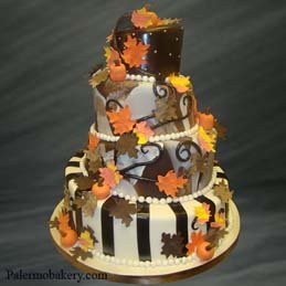 Halloween wedding ideas of a wedding cake with fall leaves