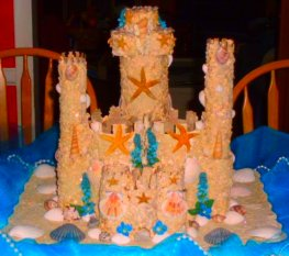 Beautiful wedding cake shapped as a sandcastle