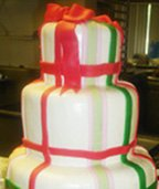 Unique Christmas wedding cake with red and green ribbon