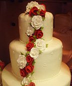 Pretty Christmas cake with red and whiteflowers